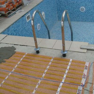 chauffage par le sol sous le carrelage des abords de piscine sol chauffant fr. Black Bedroom Furniture Sets. Home Design Ideas